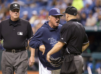 Tampa Bay Rays manager Joe Maddon argues with home plate umpire Scott Barry after being ejected from the game against the Toronto Blue Jays during the sixth inning of their MLB American League baseball game in St. Petersburg, Florida