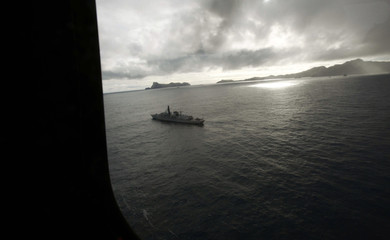 A Chilean navy ship searches for wreckage of a crashed military aircraft at Juan Fernandez Islands