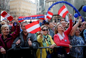 Austrian Freedom Party supporters wave flags in Vienna