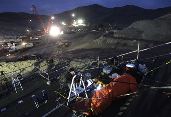 Journalists cover the operation to rescue the trapped miners at the San Jose mine