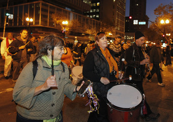 Demonstrators march to City Hall plaza in Oakland