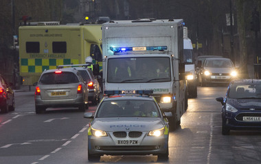 A convoy carrying an Ebola patient arrive at the Royal Free Hospital in London