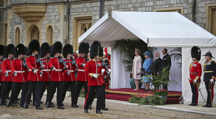 Britain's Queen Elizabeth, the President of Ireland Michael D. Higgins, his wife Sabina Higgins and Prince Philip watch a ceremonial welcome at Windsor Castle in Windsor, southern England