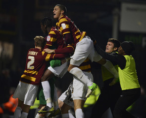 Bradford City's players celebrate after winning a penalty shootout against Arsenal during their English League Cup soccer match in Bradford