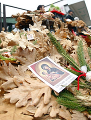 Dried oak leaf branches, symbols of the traditional Yule log, are displayed for sale in Belgrade