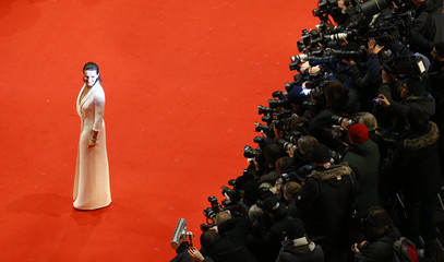 French actress Binoche arrives for screening during opening gala of 65th Berlinale International Film Festival in Berlin