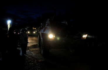 Armoured Personnel Carrier (APC) drives along a main street to reinforce government soldiers on their continuous assault with insurgents from the so-called Maute group, who has taken over large parts of the city, in Marawi