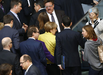 German Chancellor Merkel and fellow deputies leave after casting vote on approval to extend Greece's bailout during Bundestag session in Berlin