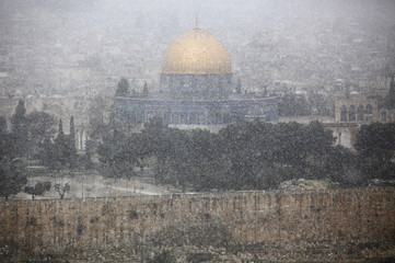 The Dome of the Rock is seen during a snow storm from Mount of Olives in Jerusalem