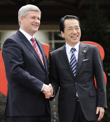Canada's Prime Minister Stephen Harper welcomes Japanese Prime Minister Naoto Kan at the G8 summit in Huntsville