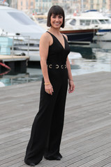 """Actress Constance Zimmer poses during a photocall for the television series """"UnREAL"""" during the annual MIPCOM television programme market in Cannes"""