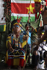 Surinamese Arawak, Jubitana, watches a warrior dance during the ceremony of his inauguration as the new captain at Hollandse Kamp village in Para