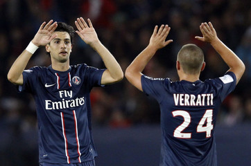 Paris St Germain's Pastore celebrates with teammate Marco Verratti after scoring his goal against Toulouse during their French Ligue 1 soccer match at the Parc des Princes stadium in Paris