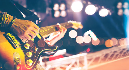 Stage lights.Abstract musical background.Playing guitar and concert concept.Live music background vintage style.Concert and music festival.Instrument on stage and band