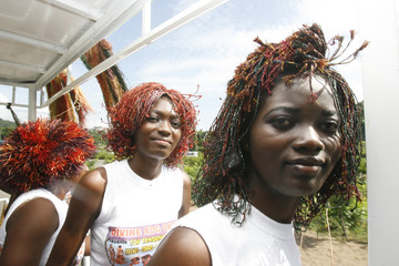Models display wigs made with raffia, a natural fibre drawn from a palm tree, during a fashion show organized by Ivorian designer Genevieve Koukougnon, in Abidjan