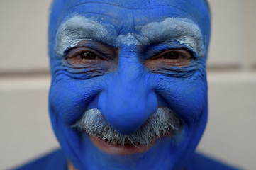 John Walker poses for a photograph in costume during an Irish tradition of Hunting of the Wren festival held every St. Stephen's Day in Dingle