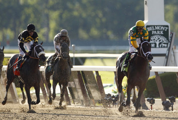 Palace Malice, with jockey Mike Smith in the irons, wins the 145th running of the Belmont Stakes, the final leg of horse racing's triple crown, at Belmont Park in Elmont