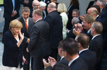 Dignitaries applaud German Chancellor Merkel on her 60th birthday before lecture in Berlin