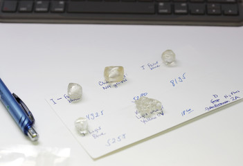 Large uncut diamonds from the Leo Schachter Diamond Group's allocation sit next to a computer keyboard at De Beers offices in central London