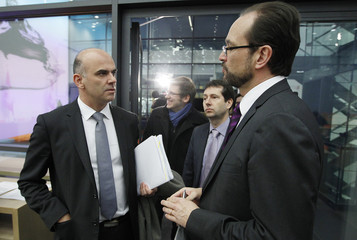 Swiss Interior Minister Berset speaks to Strupler Director of the BAG beforeg a news conference after the weekly meeting of the Federal Council in Bern
