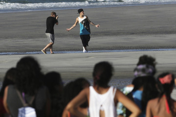 Justin Bieber performs at beach surrounded by fans in a resort in Punta Chame, on outskirts of Panama City
