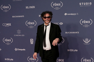Argentine singer-songwriter Fito Paez poses on the Fenix Ibero-American Film Awards red carpet, in Mexico City