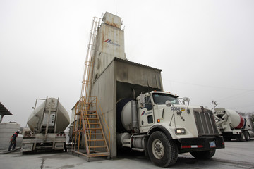 A concrete mixer truck of Mexican cement maker CEMEX, is loaded at a concrete plant in Monterrey