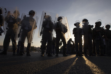 Israeli border police officers stand guard during a protest by Jewish settlers near the West Bank settlement of Beit El, near Ramallah