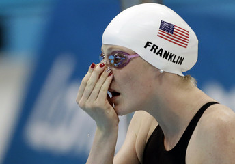 Missy Franklin of the U.S. adjusts her nose clip before heat 6 during the women's 100m backstroke heats at the London 2012 Olympic Games at the Aquatics Centre
