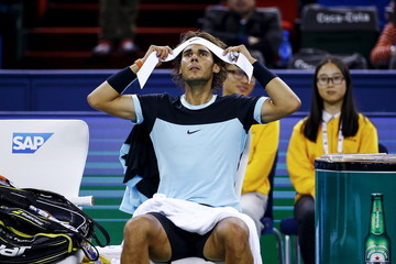 Rafael Nadal of Spain changes headband in between games against Jo-Wilfried Tsonga of France in their men's singles semi-final match at the Shanghai Masters tennis tournament in Shanghai