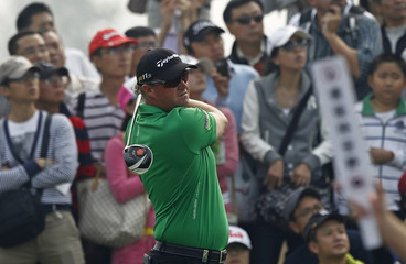 Hanson of Sweden tees off on fifth hole during final round of BMW Masters tournament at Lake Malaren Golf Club in Shanghai