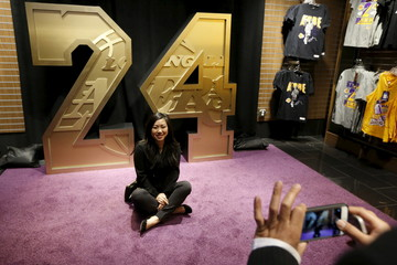Lily Chen, 26, who said she has been a Lakers fan her whole life, poses for a photo in the Lakers store at Staples Center on the last day of Kobe Bryant's 20-year career with the team, in Los Angeles