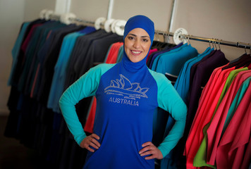 f7044747c65c6 Credit Line. REUTERS / Jason Reed - stock.adobe.com. Australian muslim  swimming instructor Fadila Chafic wears her full-length 'burkini' swimsuit  during ...