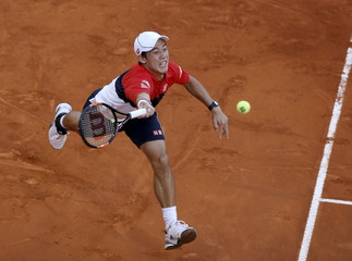 Japan's Kei Nishikori returns the ball to Britain's Andy Murray during their semi-final match at the Madrid Open tennis tournament in Madrid, Spain