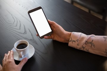 Hands of businesswoman using smart phone