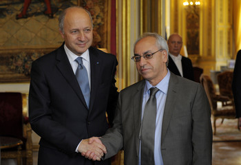 France's Foreign Minister Laurent Fabius shakes hands with Syrian National Council (SNC) leader Abdel Basset Sayda prior to a meeting at the Quai d'Orsay Ministry in Paris