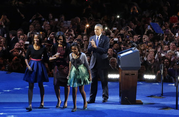 U.S. President Barack Obama walks with his family after addressing supporters during his election night rally in Chicago