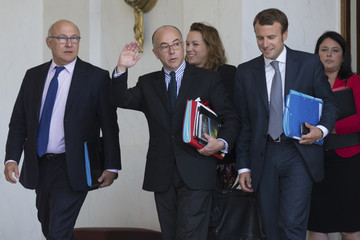 French ministers leave the Elysee Palace following the weekly cabinet meeting in Paris