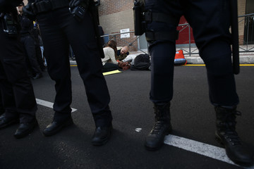 An injured demonstrator is seen on the ground in between a line of police officers after animal rights activists tried to stop the van presumably carrying Excalibur in Alcorcon