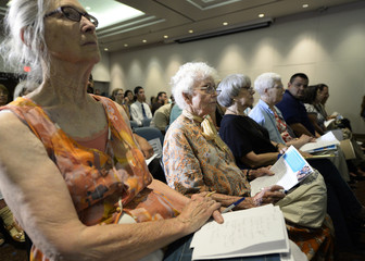 Town hall attendees listen to Peter Lee, executive director of Covered California, during a community forum on the Affordable Care Act hosted by Senators Diane Feinstein and Barbara Boxer in Long Beach California