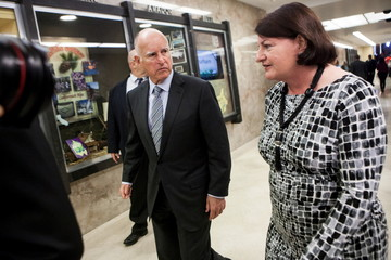 California Governor Brown and Assembly Speaker Atkins walk through the State Capitol after a news conference in Sacramento