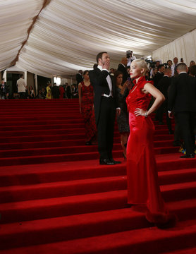 """British singer Ora poses for photographers as U.S. designer Ford stands in the background as they arrive for the Metropolitan Museum of Art Costume Institute Gala 2015 celebrating the opening of """"China: Through the Looking Glass,"""" in Manhattan"""