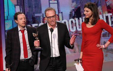 Director Kirby Dick and producers Ziering and Barklow accept the award for best documentary at the 2013 Film Independent Spirit Awards in Santa Monica