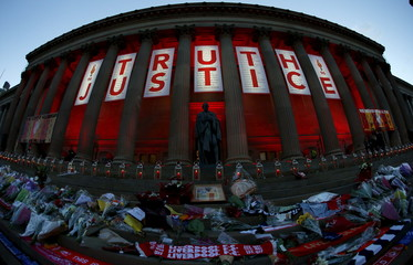 St Georges Hall is illuminated red following a vigil in  memory of the victims of the Hillsborough disaster in Liverpool, northern England