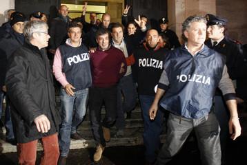 Italian policemen escort Camorra boss Antonio Iovine as they leave the police headquarters in Naples