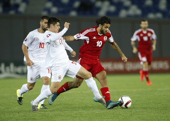 Georgia's Tornike Okriashvili fights for the ball with Gibraltar's Anthony Bardon during their Euro 2016 qualifying soccer match in Tbilisi