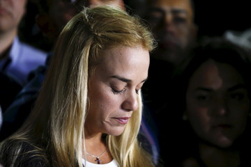 Lilian Tintori, wife of jailed opposition leader Leopoldo Lopez, looks down during a news conference in Caracas