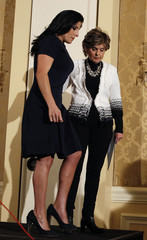 Natalie Khawam, twin sister of Jill Kelley, and attorney Gloria Allred leave after a news conference in Washington