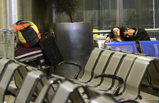 A couple sleeps inside Thessaloniki's airport in northern Greece