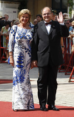 German Agriculture Minister Schmidt and politician Woehrl arrive on the red carpet for the opening of the Bayreuth Wagner opera festival in Bayreuth
